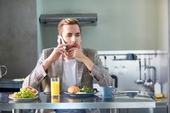 Calling in the kitchen Royalty Free Stock Image