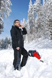 Calling mountaineer. Calling phoning mountaineer tourist in winter mountains Royalty Free Stock Images