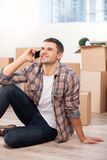 Calling from a new apartment. Royalty Free Stock Image