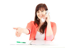 Calling nice assistant with clipboard and pen Royalty Free Stock Photography