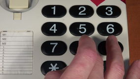 Calling  number with vintage touch tone telephone stock footage