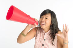 Calling Out. Young woman calling out cheerful with a red plastic cone Stock Images