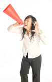Calling Out. Young woman calling out cheerfully with a red plastic cone Royalty Free Stock Photo