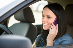 Calling phone while driving car Stock Photography