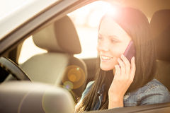 Calling phone while driving car Stock Images