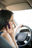 Calling phone while driving car Royalty Free Stock Photos