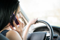 Calling phone while driving car Royalty Free Stock Images
