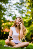 Calling phone - multitasking Royalty Free Stock Images