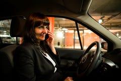 Calling phone- senior business woman  in car Stock Photos