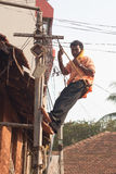 Calling from the pole. Power lineman in Karnataka, India Royalty Free Stock Image