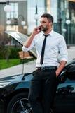 Calling roadside assist. Royalty Free Stock Photo