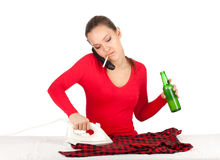 Calling smoking ironing young woman drinking beer Stock Photos