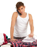 Calling smoking young man ironing clothes Royalty Free Stock Images