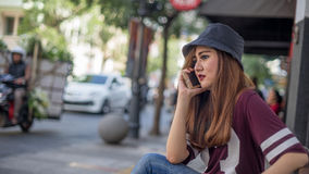 Calling somebody. Call somebody in the street side Stock Photos
