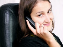 Calling someone 2. Happy woman using a mobile phone royalty free stock photo