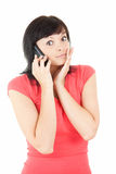Calling surprised young woman with mobile phone Royalty Free Stock Photo