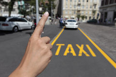 Calling a taxi. And detail of written Royalty Free Stock Photo