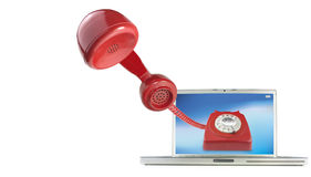 Calling by telephone over the internet. Using a computer Stock Photo