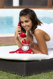 Calling with a telephone Royalty Free Stock Image