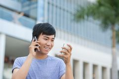 Calling and texting Stock Images