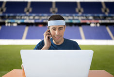 Calling to make your bet from a stadium Royalty Free Stock Images