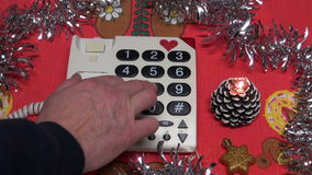 Calling with vintage telephone with christmas decorations stock video footage