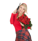Calling woman with a bouquet of roses Royalty Free Stock Images