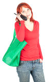 Calling woman with green shopping bag Stock Image