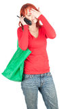 Calling woman green shopping bag Stock Images