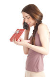 Calling woman with present box Stock Images