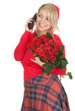 Calling woman with red roses Royalty Free Stock Images