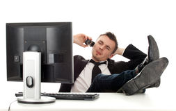 Calling young businessman with computer Stock Image