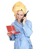 Calling young woman in bathrobe with gift box Stock Photo