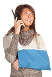 Calling young woman with broken hand Royalty Free Stock Photo