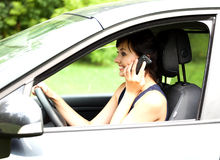 Calling young woman in the car Stock Photo
