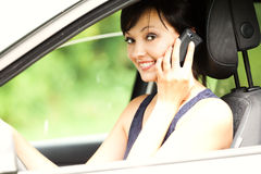 Calling young woman in the car Stock Image