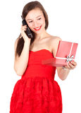 Calling young woman keeping red present box Stock Image