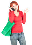 Calling young woman with shopping bag Royalty Free Stock Photos