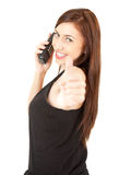 Calling young woman with thumb up Stock Photos