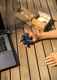 Calliope mini on August 25th 2017 in Luedershagen, Germany. German programming platform Calliope mini unboxed in child`s hands Stock Photo