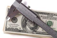 Calliper and Dolars Stock Photo