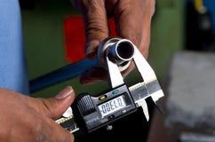 Calliper measuring an iron bar Royalty Free Stock Image