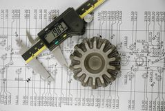 Calliper and mechanical part. On engineering drawing Royalty Free Stock Photography