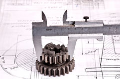 Calliper with part on Engineering drawing Royalty Free Stock Photography