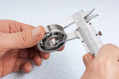 Callipers with bearing in hand Royalty Free Stock Image
