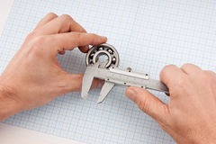 Callipers with bearing in hand Stock Photography