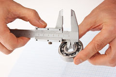 Callipers with bearing in hand Royalty Free Stock Photos