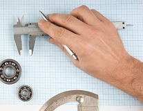 Callipers in hand Stock Image