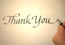 Callligraphy thank you. Person writing thank you in calligraphy Royalty Free Stock Images