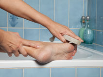 Callous feet and pumice stone Royalty Free Stock Photo